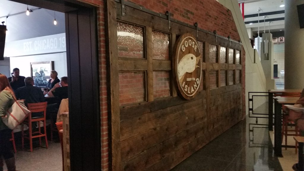 Goose Island Brewery's 402 Barn Door Hardware from Specialty Doors. A large door slab with 6 rollers & hangers on a flat track.