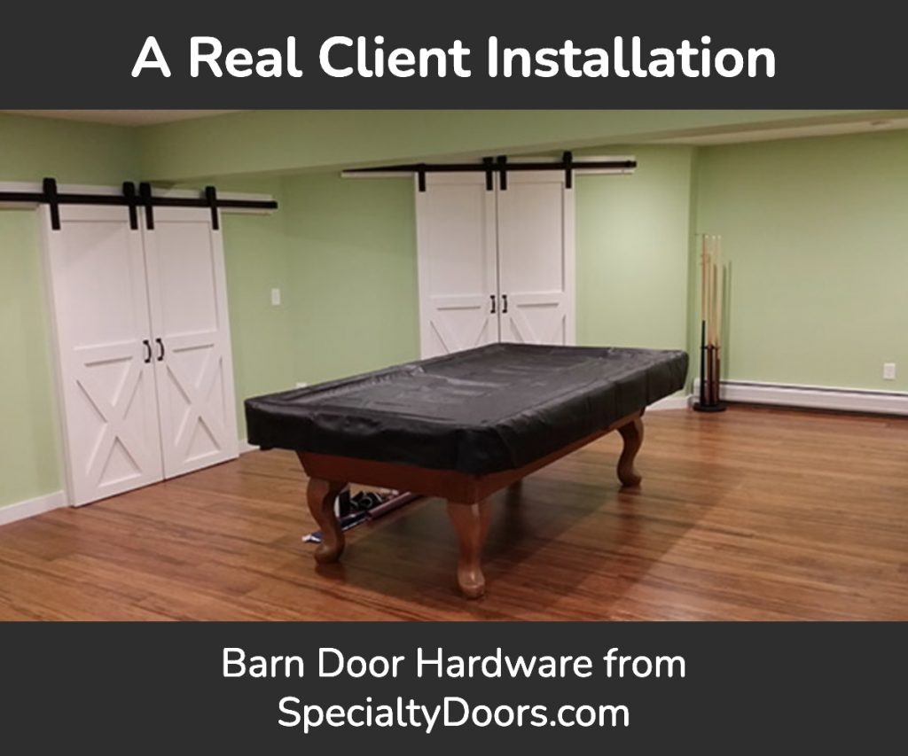 A Real Client Installation | Barn Door Hardware from SpecialtyDoors.com. Two pairs of bi-parting barn doors in a room with a covered pool table.